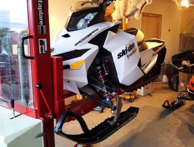 Хранение снегохода в гараже