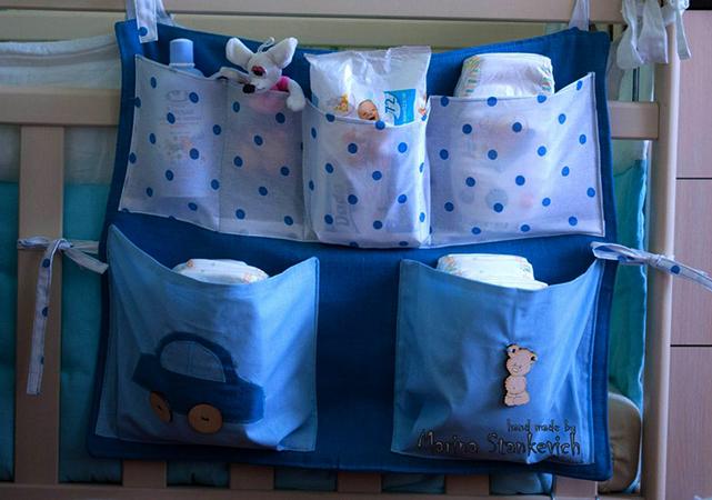 Кармашки на кроватке для новорожденного
